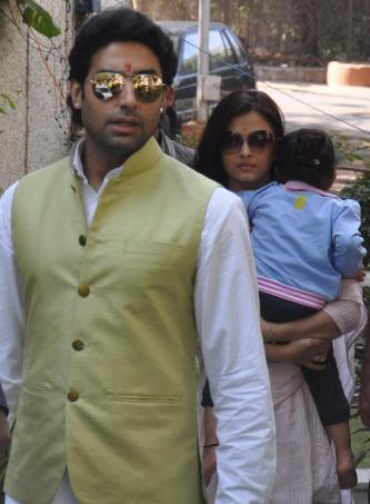 Actors Abhishek Bachchan and Aishwarya Rai Bachchan and daughter Aaradhya at Bhopal airport in Bhopal on Dec.5, 2013. They are in the city to attend a marriage ceremony. (Photo: IANS)